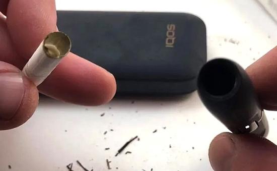 Почему в держателе IQOS может оставаться табак